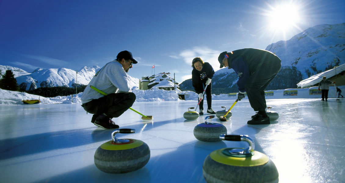 """ENGADIN ST. MORITZ - Curling ( Mitte Dezember bis Anfang Maerz) 'Rolling Stones' in St. Moritz: Seit 1881 finden im Curling-Center 'Al Parc' beim Kulm-Hotel auf 8 bis 16 Natureis-Rinks taeglich Trainings und Turniere statt.   Curling ( Mid of December to the begin of March)  """"Rolling Stones"""" in St. Moritz: For over 100 years there have been practice matches as well as major tournaments held at the """" Al Parc"""" Curling Centre near the Kulm Hotel.   Copyright by ENGADIN St. Moritz By-line: swiss-image.ch/Christian Perret"""